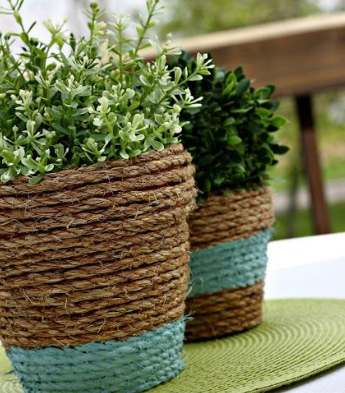 two flower pots wrapped with rope around them