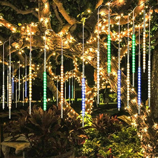 A bunch of long skinny lights hanging from a tree.