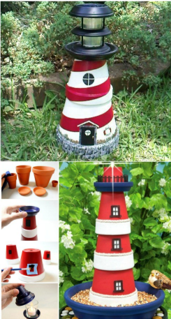 A red and white lighthouse decoration made of flower pots standing upright on grass