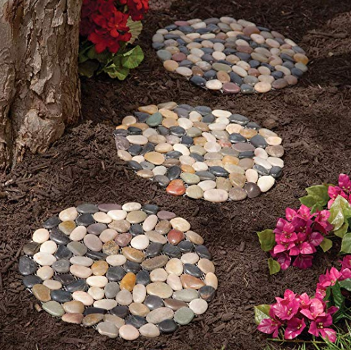 Three stepping stones made out of river stones aligned in front of each other