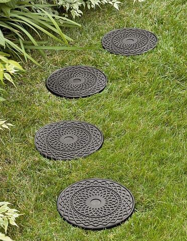Four stepping stones made out of grey rubber.