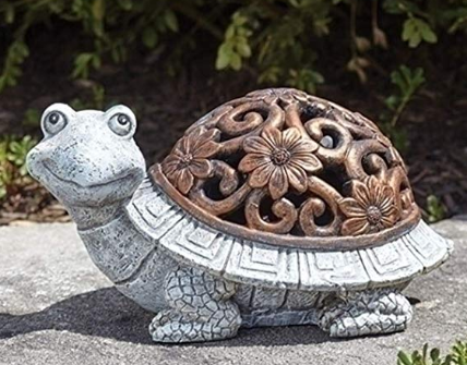 A stone silver turtle decoration standing on cement