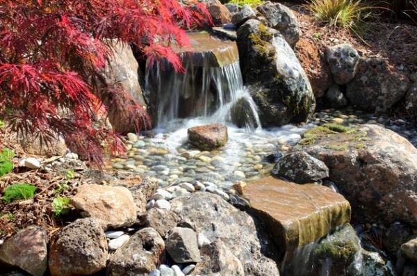 A mini waterfall in the garden.