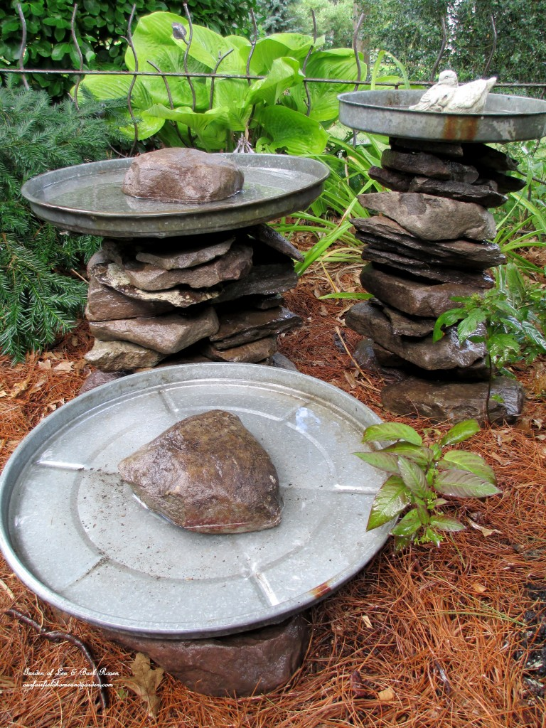Stacked stones with lids birdbath.