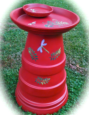 Upside red terracotta with dragonflies birdbath.