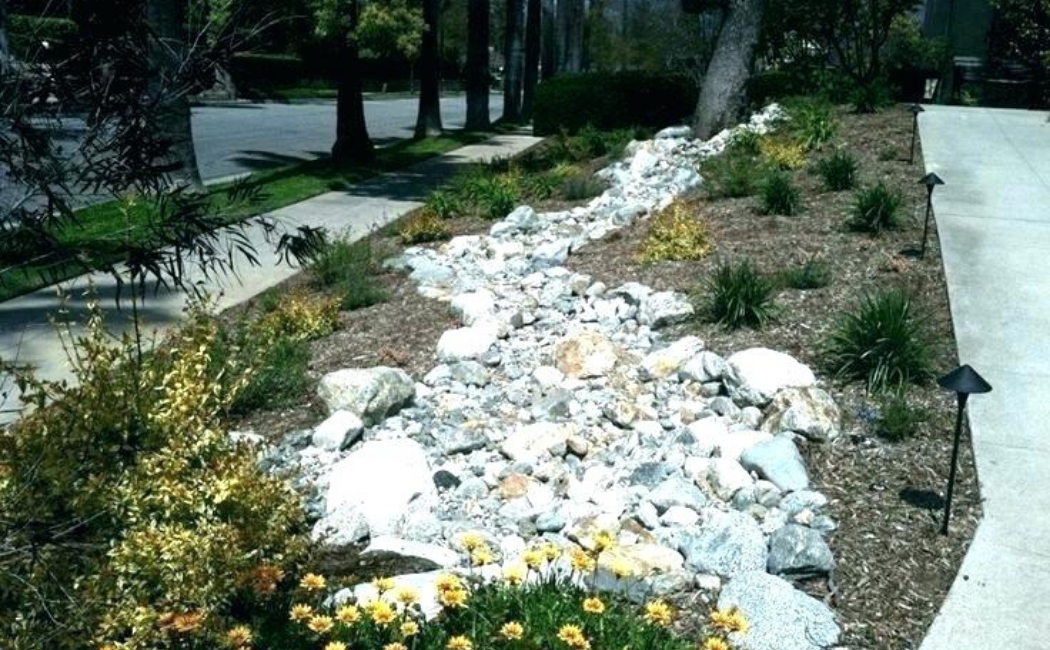 A dry creek bed on the roadside.