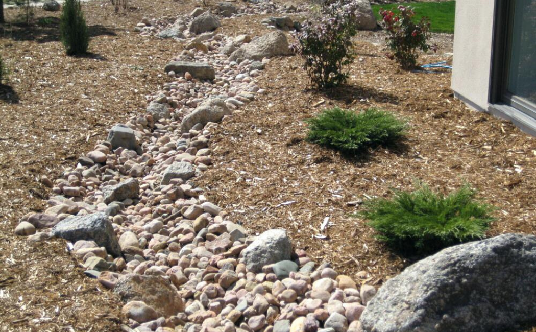 A dry creek bed of rocks and stones.