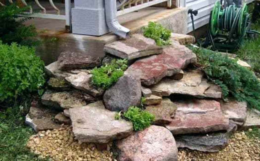A stack of stones to guide rainwater away from the backyard.