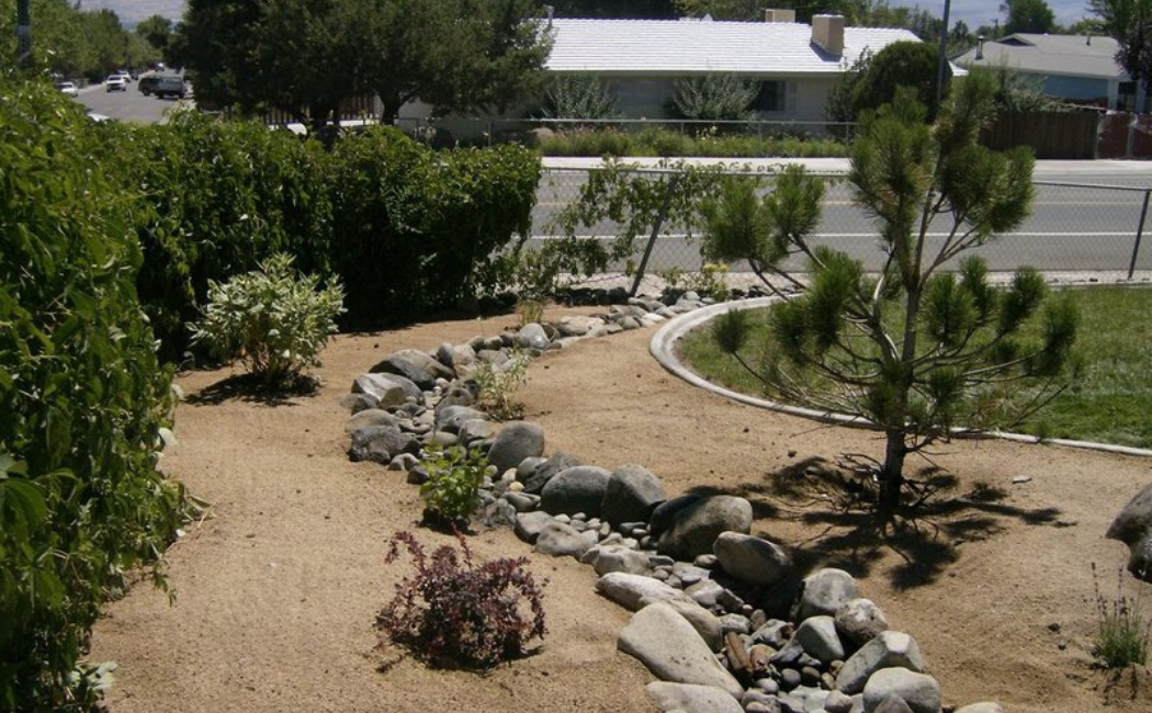 A dry creek bed at the center of the sand garden.