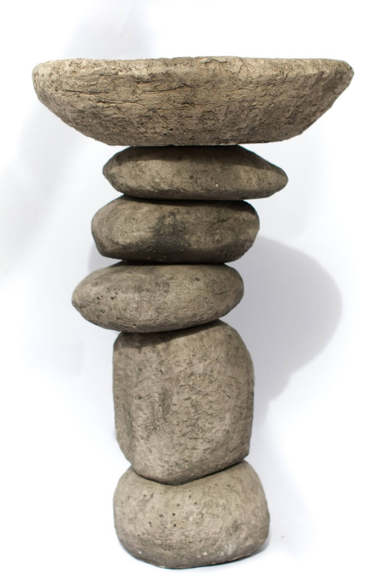 Zen-inspired stacked stone birdbath.