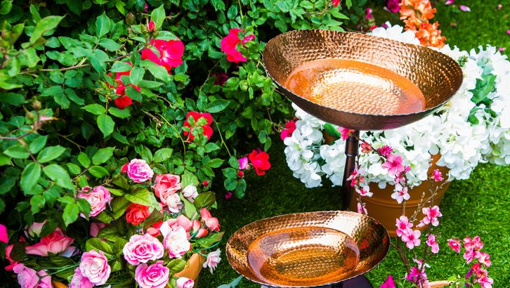 Two-tier copper birdbath.