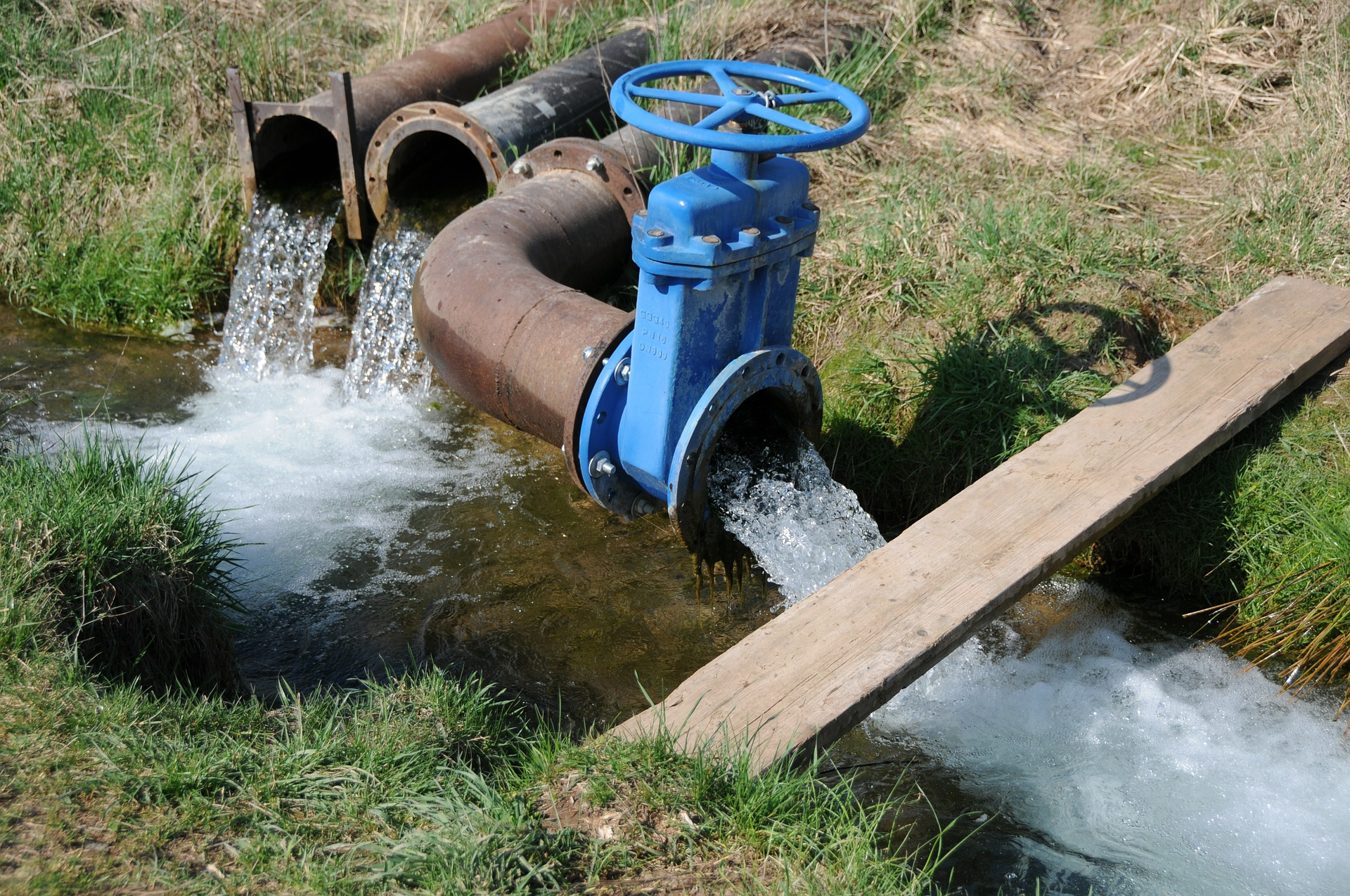 Water irrigation system using large steel pipes.
