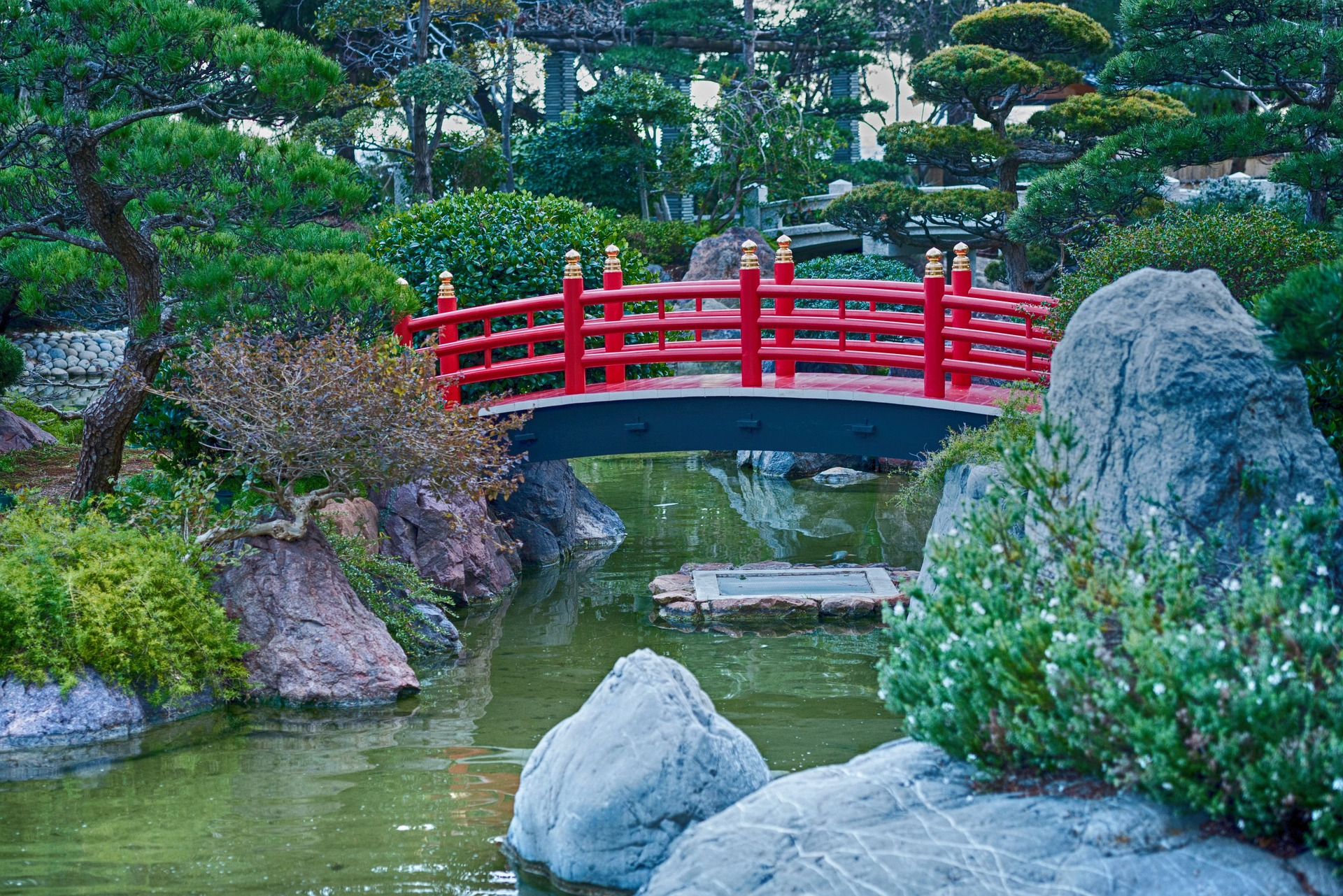 An arching bridge painted in red.