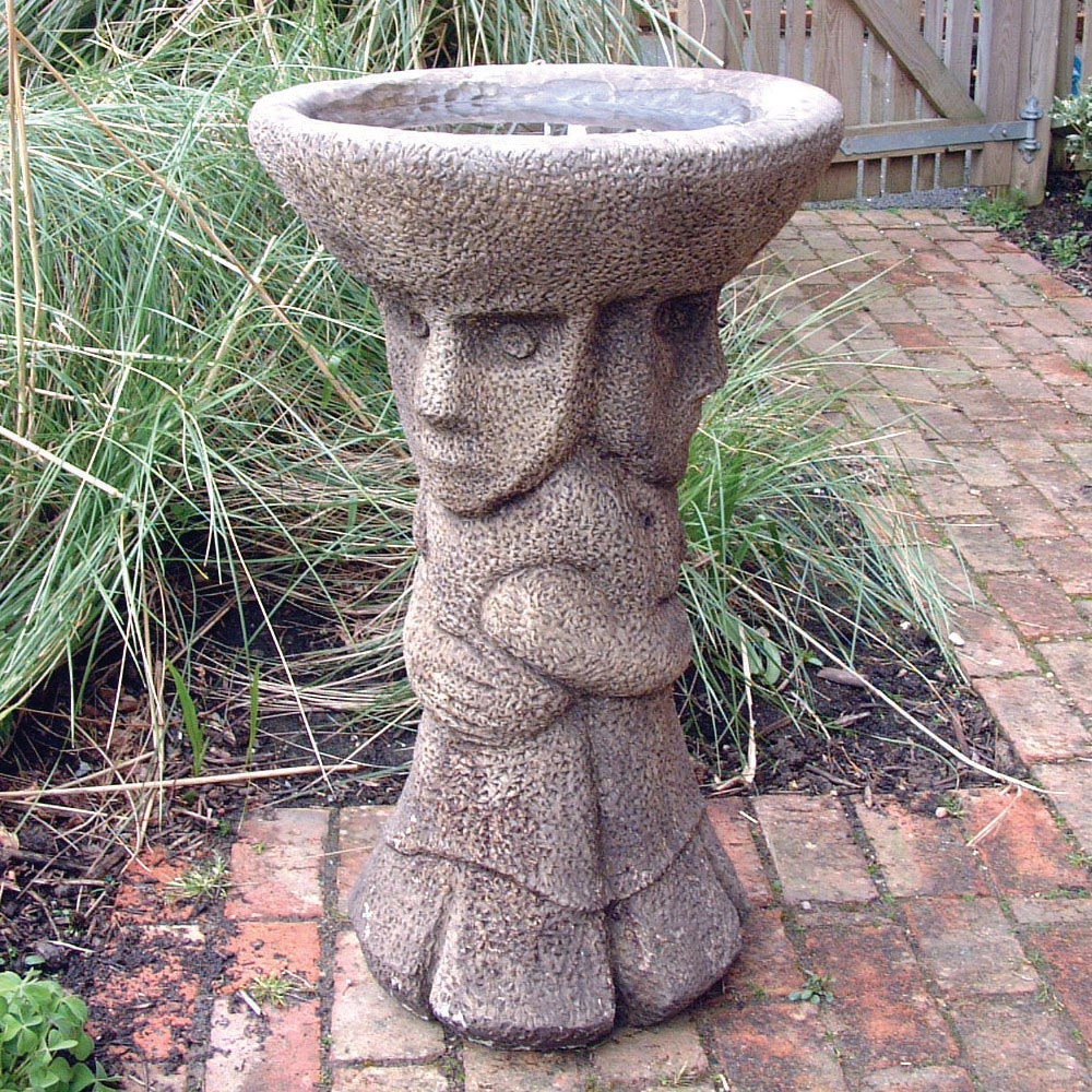 Elf-inspired concrete birdbath.