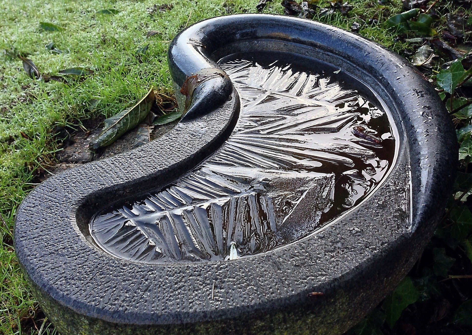 Concrete birdbath with modern design.