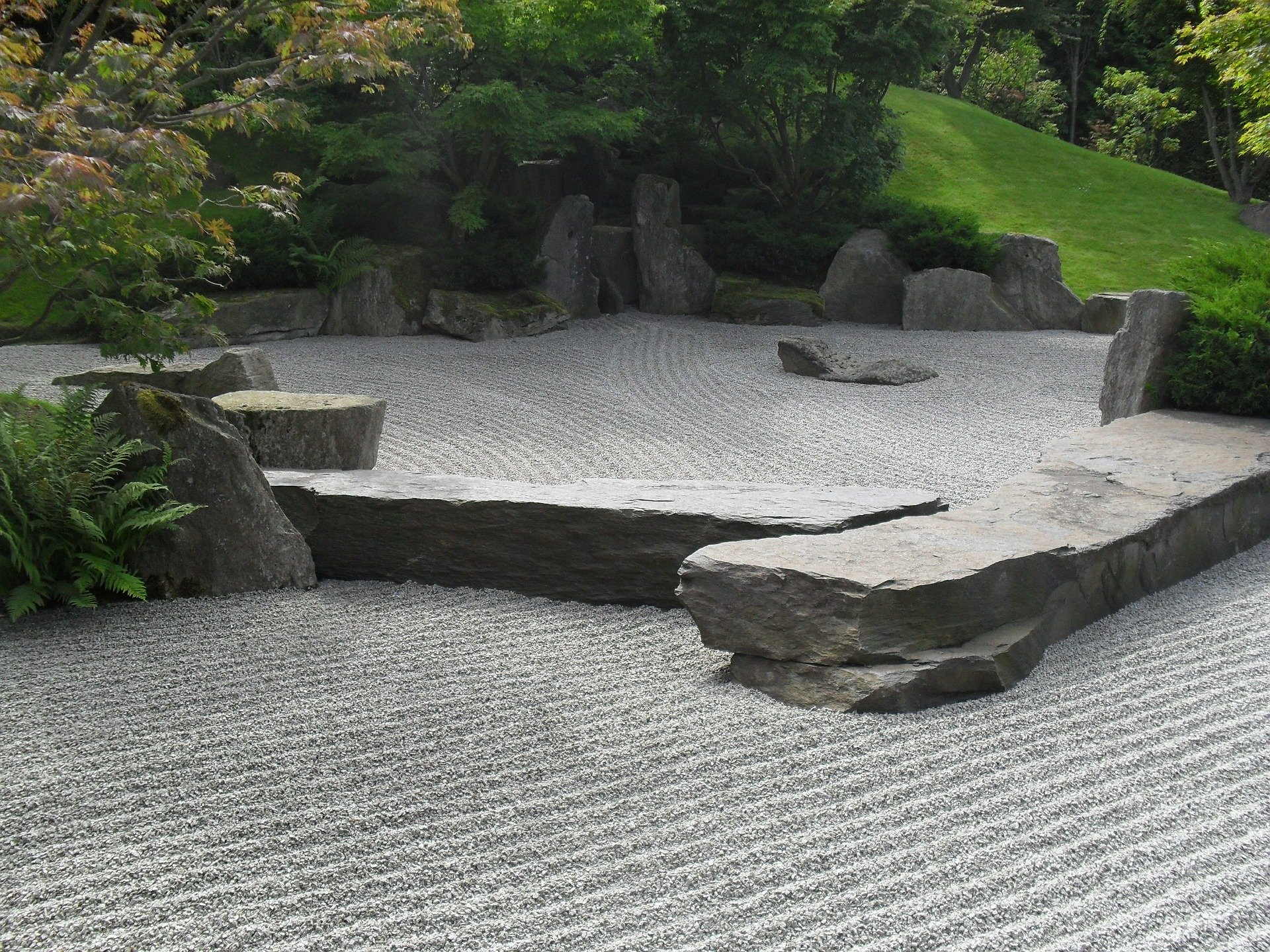 Backyard zen garden with straight lines pattern.