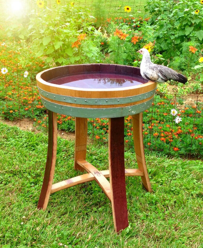 Upcycled wine barrel birdbath.