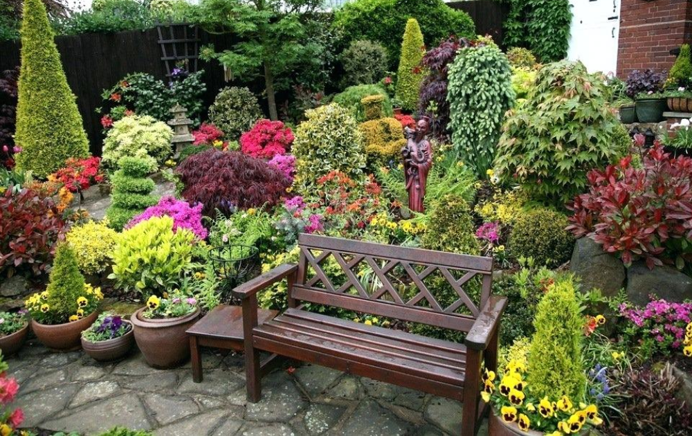 Wooden bench accentuates the colorful garden.