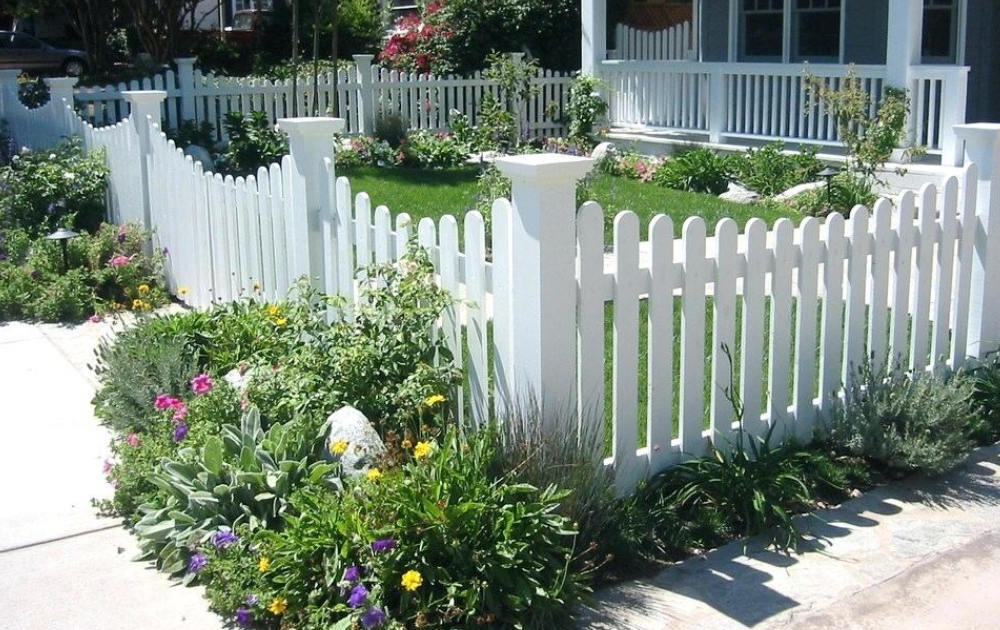 White wooden fence at the front yard.