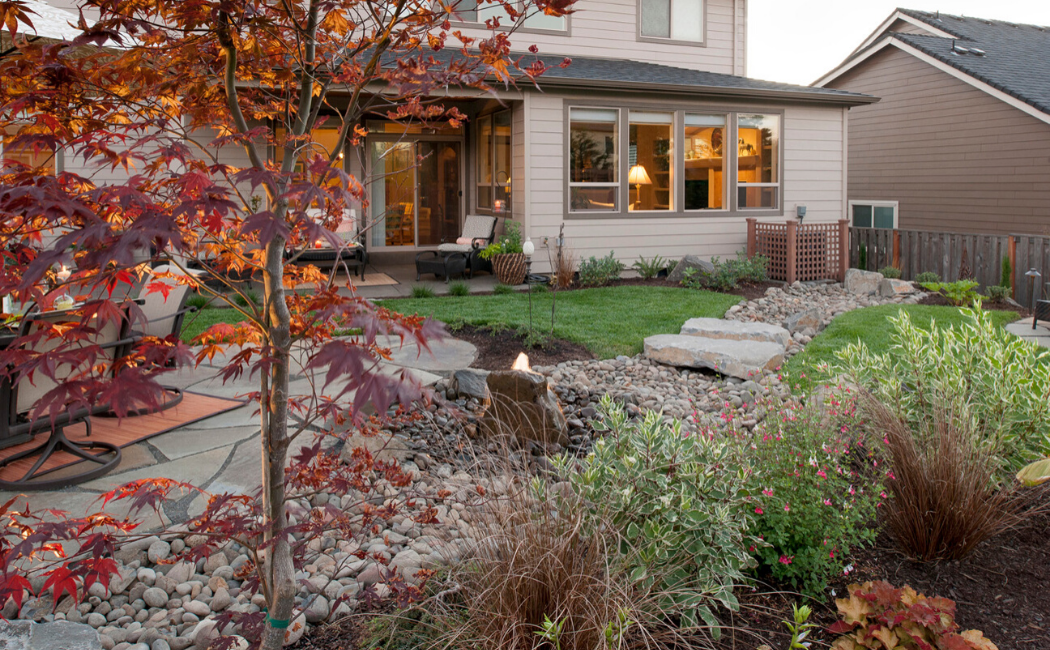 A dry creek bed at the backyard of a modern home.
