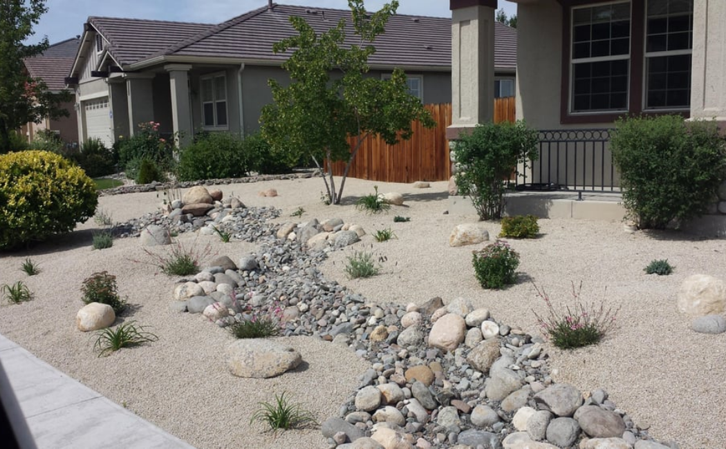 A dry creek bed at the center of the desert-inspired garden.
