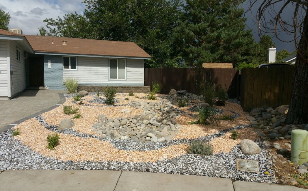 A dry creek bed at the center of the zen garden.