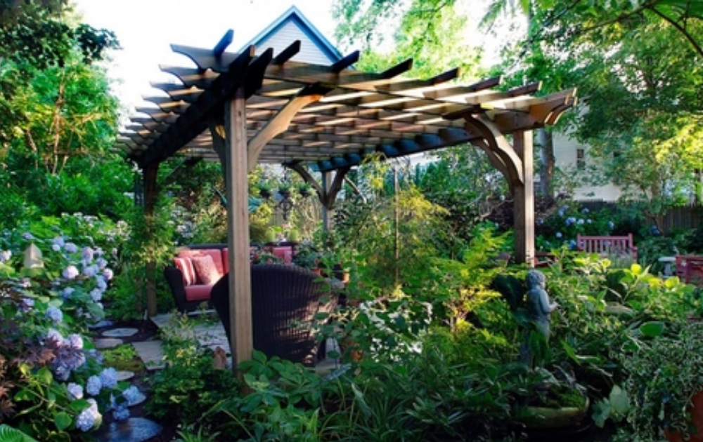 Wooden pergola with elegant garden furniture.