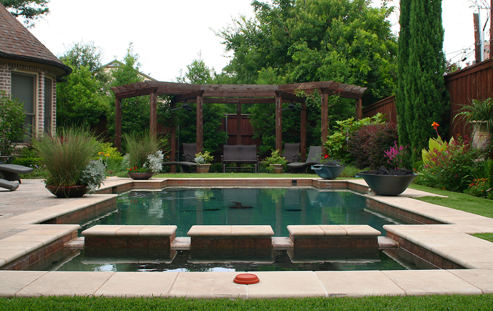 Contemporary pool design complementing the traditional English garden style.