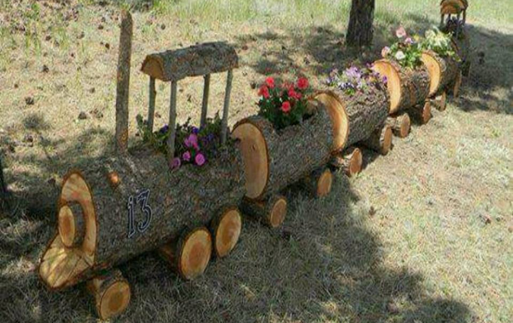 Train structure planter built out of a log.