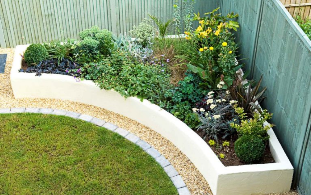 Raised bed built out of concrete with colourful flowering plants