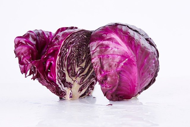 A bulb of red cabbage cut in half.