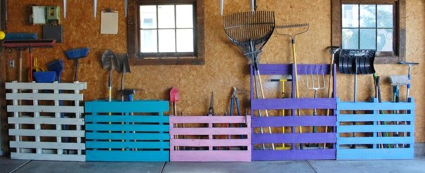 Five colourful upcycled pallets garden tool storage full of organized garden tools.
