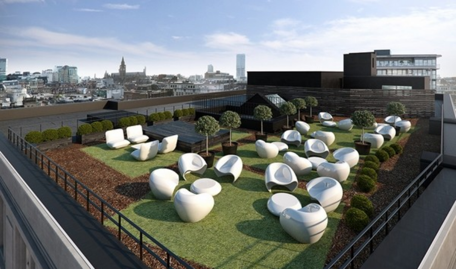 The spacious roof garden features sculptured potted topiaries, wood deck and a few sets of egg-inspired white chairs and tables.