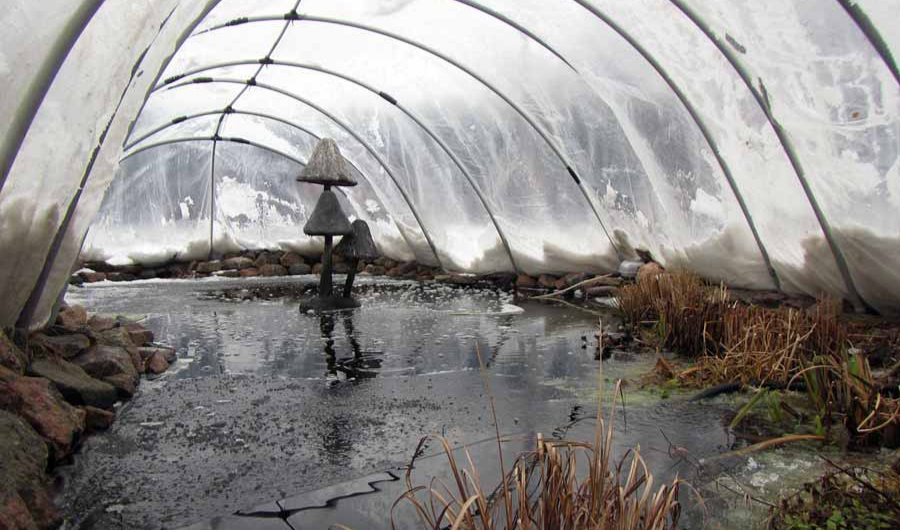 Winter pond cover made of PVC and clear plastic cellophane in the greenhouse style.