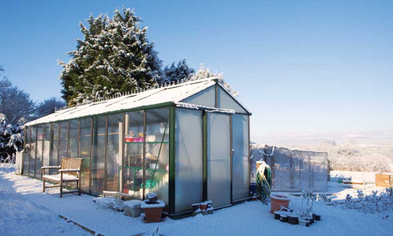 Glass greenhouse in mild winter