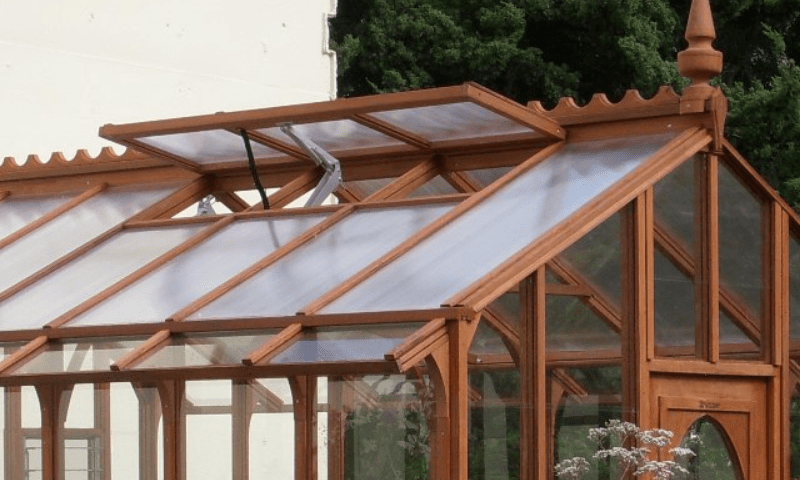 Roof vent made of glass and wood frame with an automatic opener