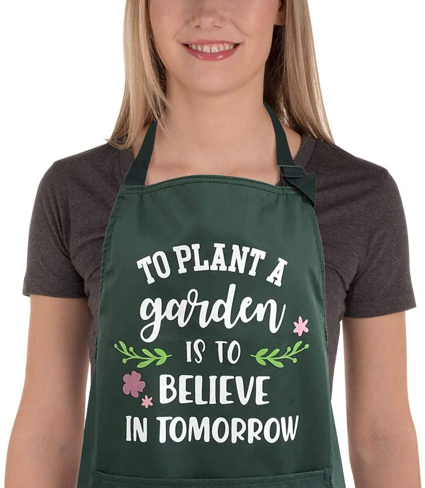 "Green apron with printed quote ""To plant a garden is to believe in tomorrow"""
