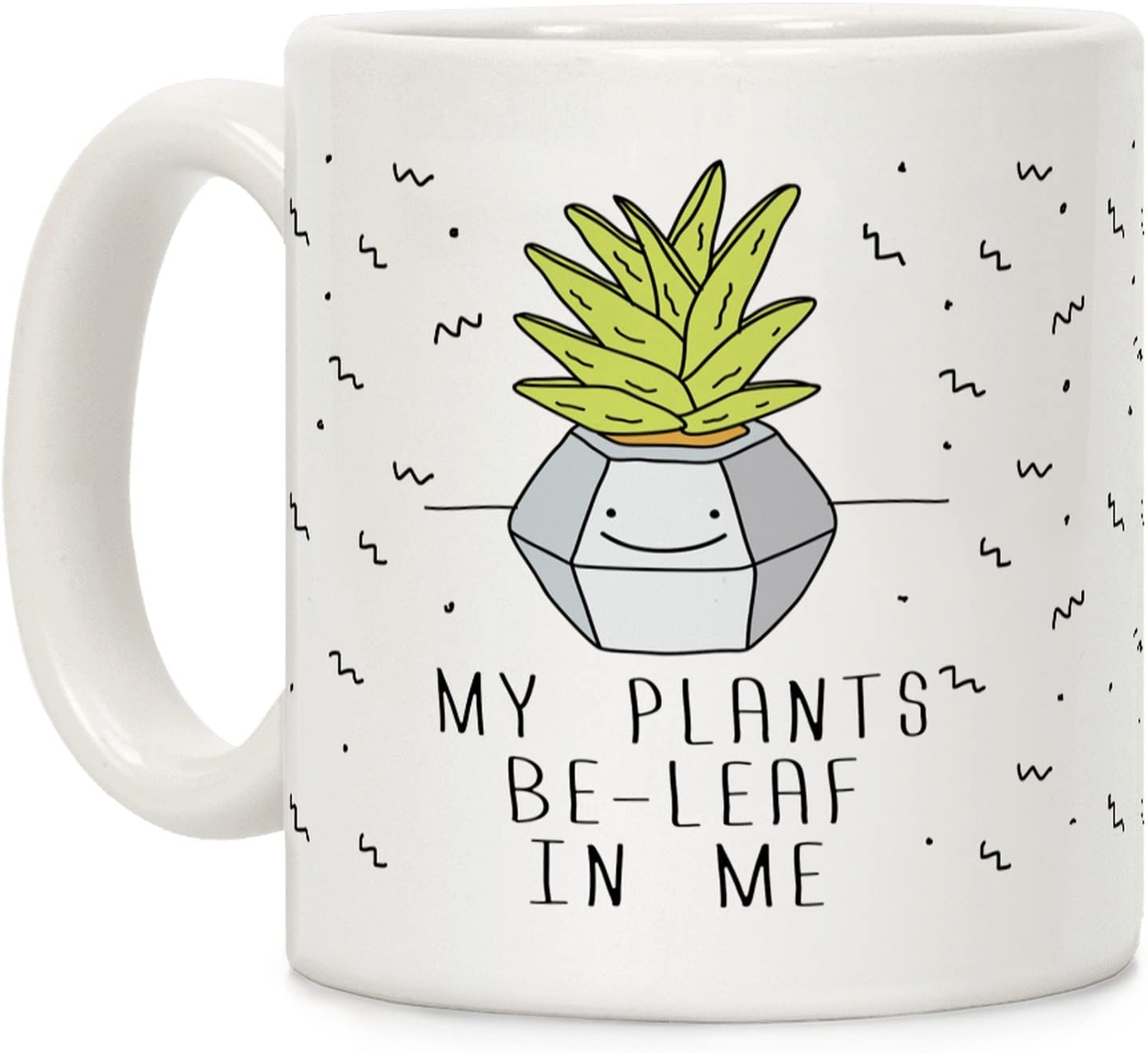 "A white mug printed with a cactus plant in a pot and quoted ""My plants be-leaf in me"""