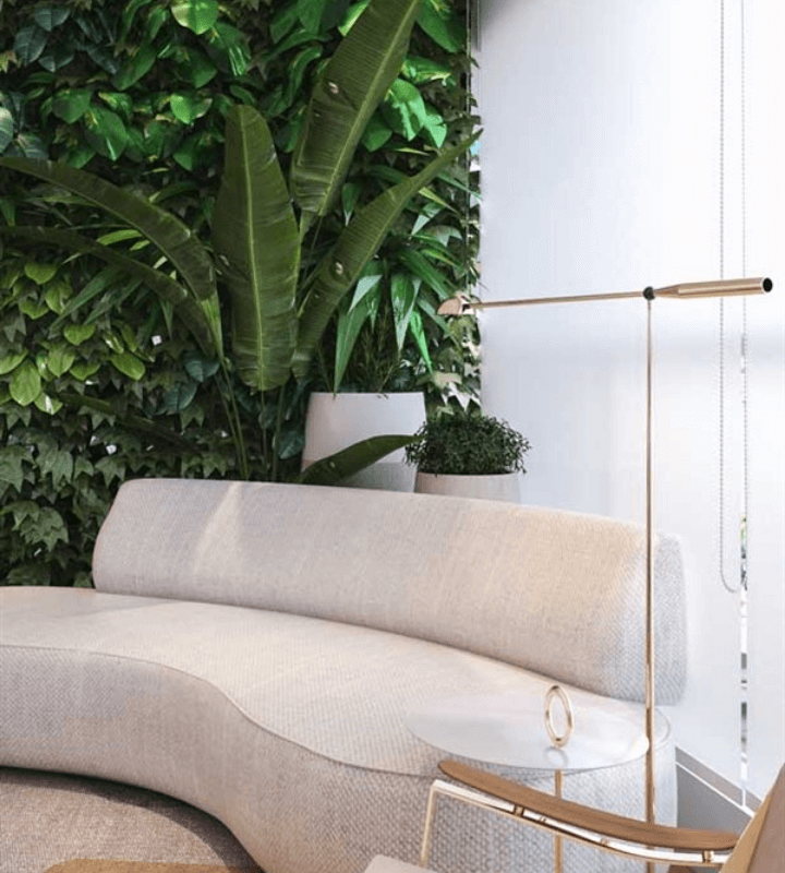 A couch next to the wall with a vertical garden