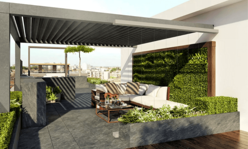 Lush green wall garden accenting behind L-shaped seating in the rooftop garden.